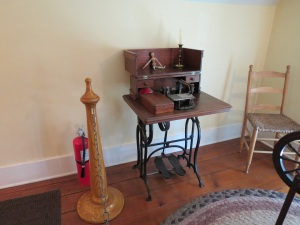 Very old sewing machine.  Note placement of sewing foot. (Click to enlarge)