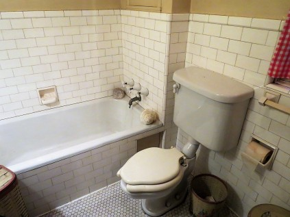 This 70 year old bathroom even includes 70 year old toilet paper.