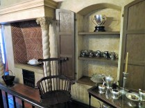 Parlor with fireplace and tea service.